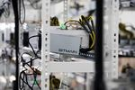 Cables are attached to an application-specific integrated circuit (ASIC) device and power unit, manufactured by Bitmain Technologies Inc..