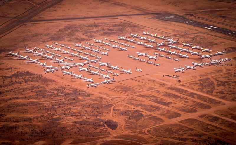 Planes are parked at a storage facility located at Alice Springs Airport