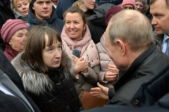 In His Hometown, Putin Gets Surprise Grilling...And Gives Gifts
