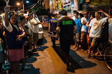 MANILA, PHILIPPINES - JULY 16:  A body of an alleged drug dealer is taken out of a crime scene on July 16, 2016 in Manila, Philippines. Philippine President Rodrigo Duterte declared a war on crime and drugs after sweeping the presidential elections on May 9 and has been living up to his nickname, 'The Punisher'. Philippine police have been conducting night time drug raids almost on a daily basis with human rights groups and the Catholic church objecting on the use of deadly force as brutal and excessive. Based on local reports, there has been at least 300 drug-related deaths since the start of July, with around 61 attributed to vigilantes and 70,000 drug addicts have surrendered themselves to the government as Duterte reassured police of his full support if they killed criminals who resisted with violence.  (Photo by Dondi Tawatao/Getty Images)