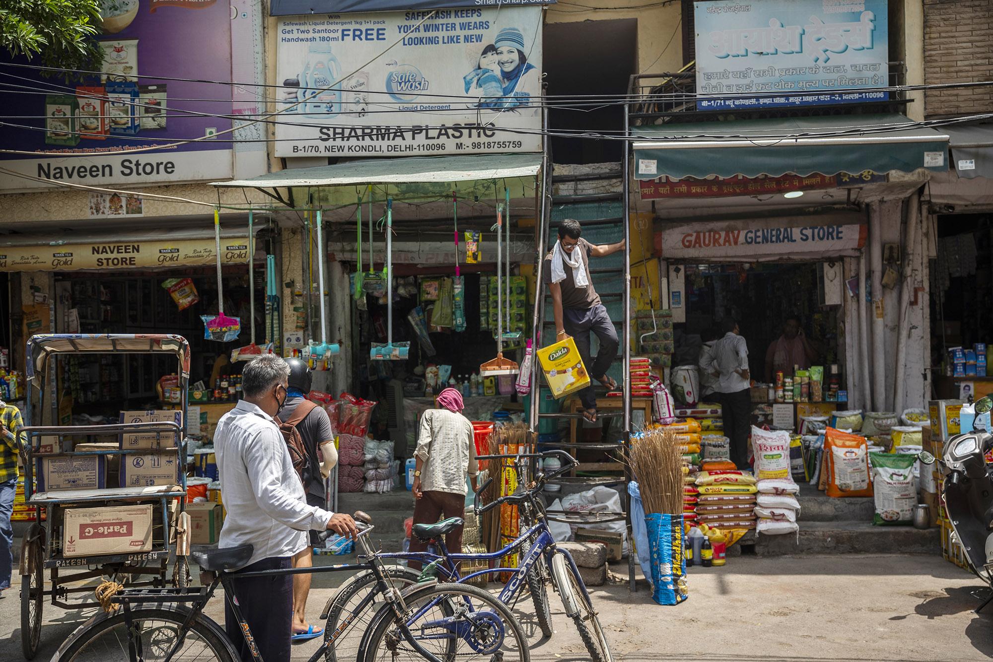 People shop at stores in Noida, Uttar Pradesh.