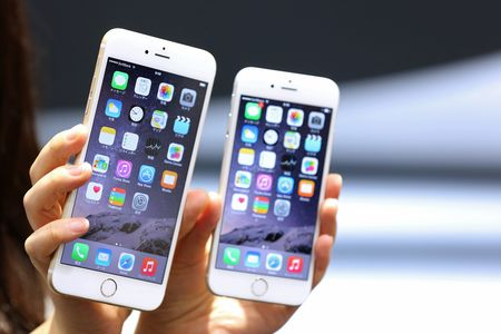 The iPhone 6 Plus, left, and iPhone 6.