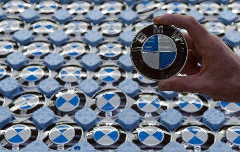 An Employee Holds A Bayerische Motoren Werke AG Badge
