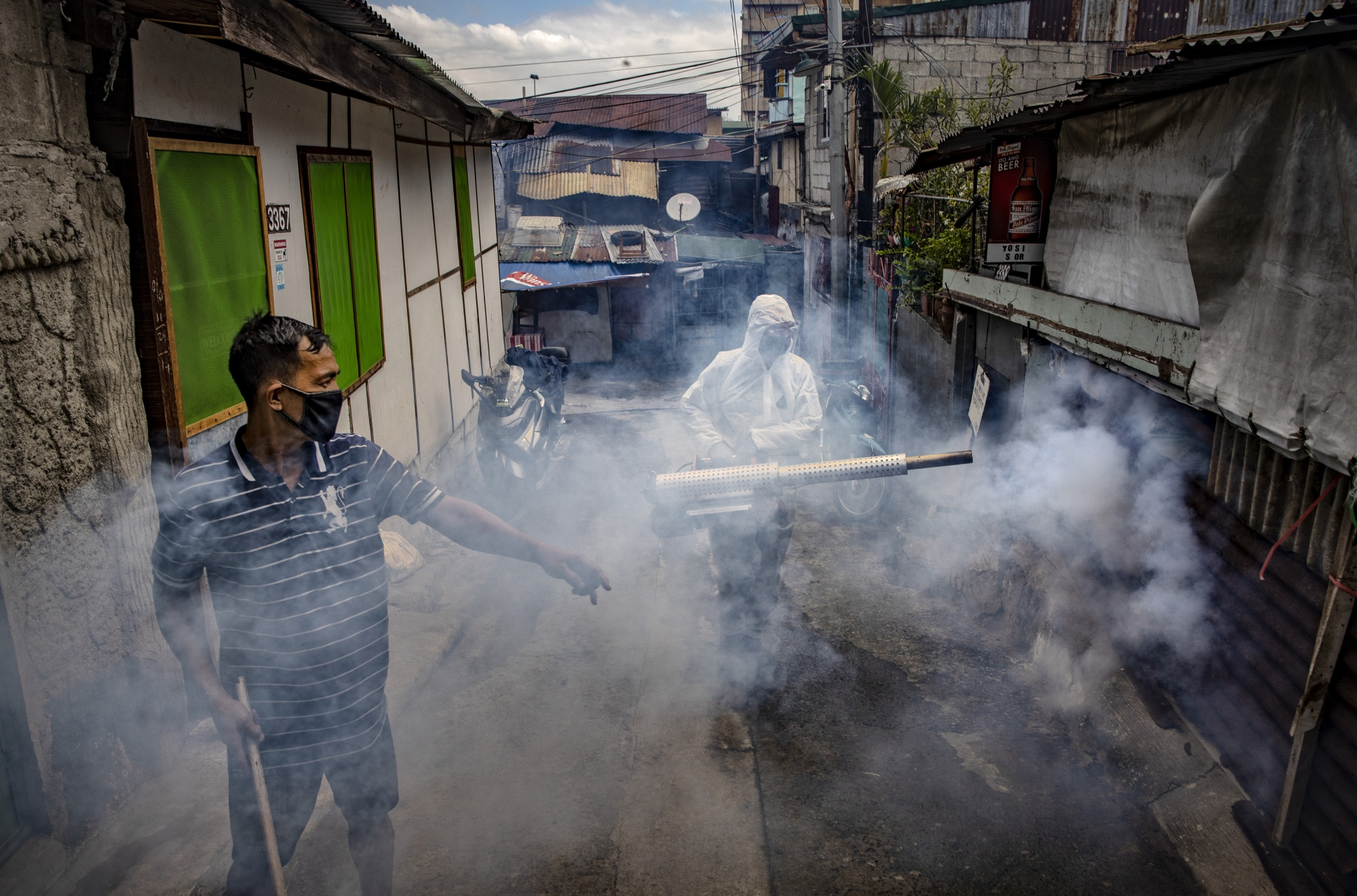 A worker disinfects a street in Manila.