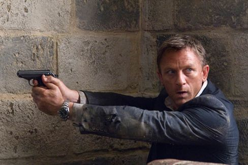 Daniel Craig, as Bond, flashes has Omega watch.