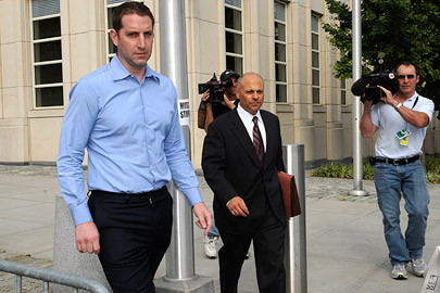 Former Credit Suisse broker Eric Butler, left, exits Brooklyn federal court with his attorney Paul Weinstein on Sept. 3, 2008
