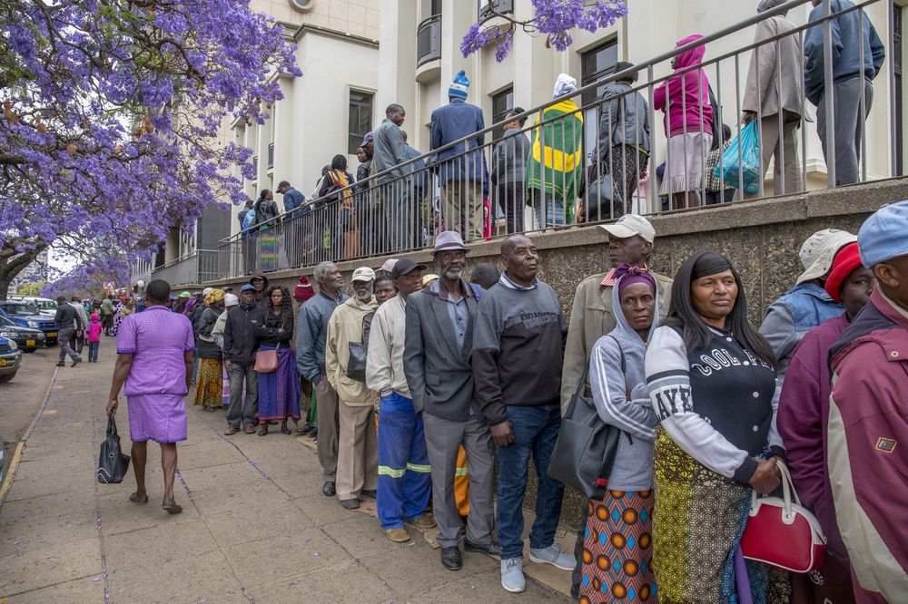 Pensioners line up to withdraw their pensions from a bank in Harare.