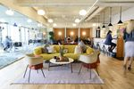 Members work in a common area at the Embarcadero WeWork Cos Inc. offices in San Francisco, California, U.S.