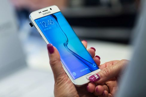 An attendee tries a Samsung Galaxy S6 Edge smartphone at a launch event in Hong Kong on April 10.