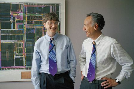 Microsoft's CEO Bill Gates, left, takes delivery of a picture from Intel's CEO Andy Grove, right, at Microsoft's headquarters in Redmond, Washington, May 13, 1993. Gates bought the picture last month for $25,000, which was donated to the Software Education Foundation. The picture is called