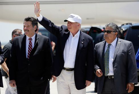 Republican presidential hopeful Donald Trump speaks after arriving at the airport for a visit to the U.S. Mexico border in Laredo, Texas, on July 23, 2015. Trump is touring the border area to highlight his concerns about immigration policies.