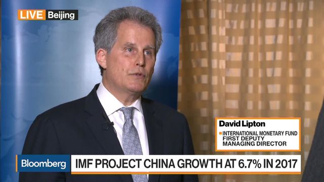 IMF urges China to speed up action on mounting debt