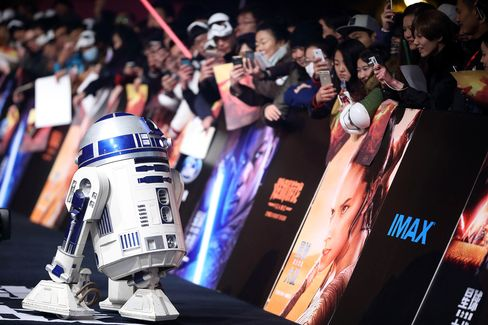 "Chinese fans look at or take pictures of the ""Star Wars"" robot R2-D2 during a premiere event of movie ""Star Wars: The Force Awakens"" in Shanghai, China, on Dec. 27, 2015."
