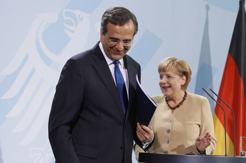 Merkel Backs Samaras on Greece's Euro Future in Snub to Critics
