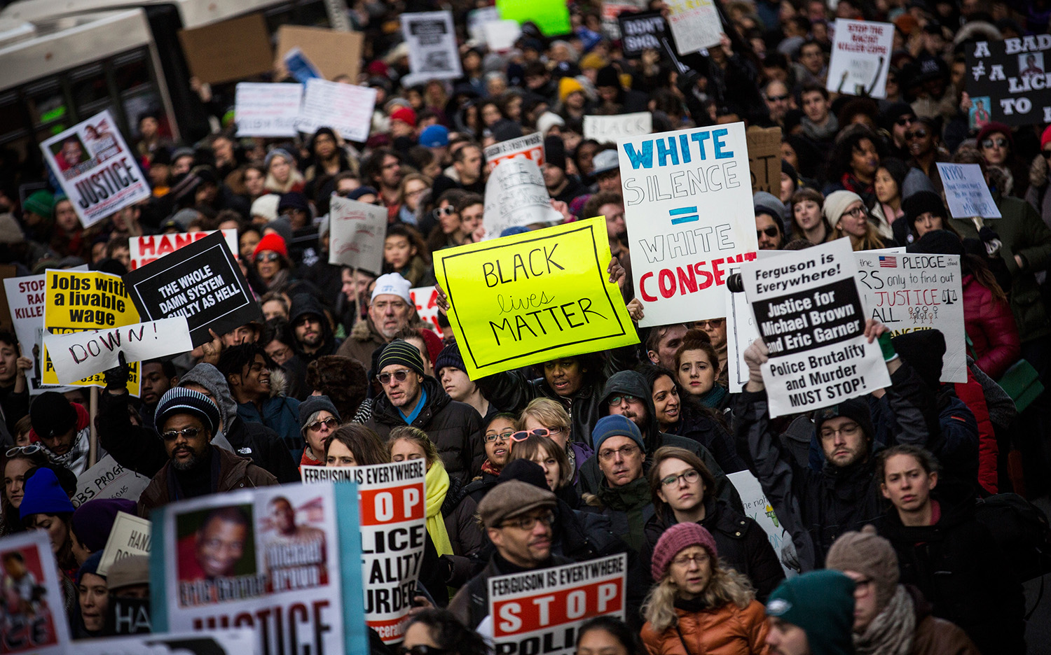People march in the National March Against Police Violence, which was organized by National Action Network, through the streets of Manhattan on December 13, 2014 in New York City.