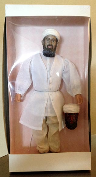 An Osama bin Laden action figure, with the regular head and the demonic version of the head below