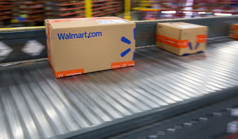 074c92ebef4 Packages move along a conveyor belt inside a Wal-Mart Stores Inc.  fulfillment center