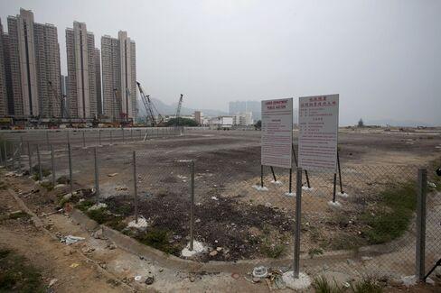 Hong Kong Land Sale Misses Estimates as Europe Roils Stocks