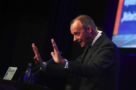 Merz Slams ECB as Laschet Touts Him for German Finance Role