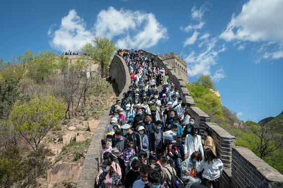 Chinese Travel Booms While Spending Still Lags Pre-Covid Levels