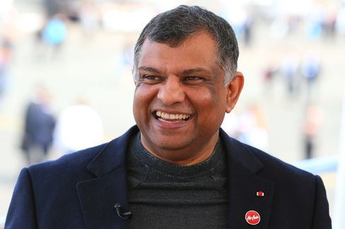 Tony Fernandes, group chief executive officer of AirAsia Bhd., reacts during a Bloomberg Television interview on day two of the 51st International Paris Air Show in Paris, France, on June 16.