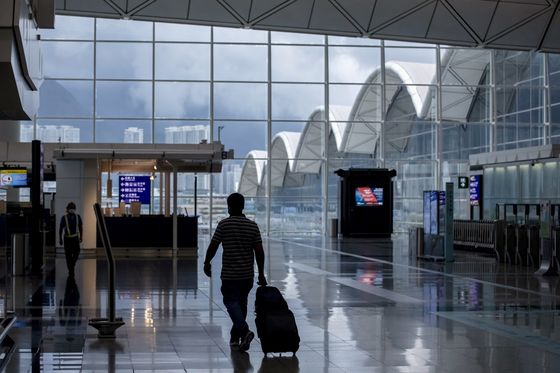 Businesses in Hong Kong Slam Tightened Covid Travel Curbs