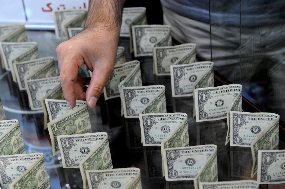 An Employee Arranges Us Dollar Notes In The Display Of A Foreign Currency Trader
