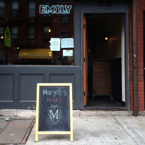 The exterior of Emily/Margot's.