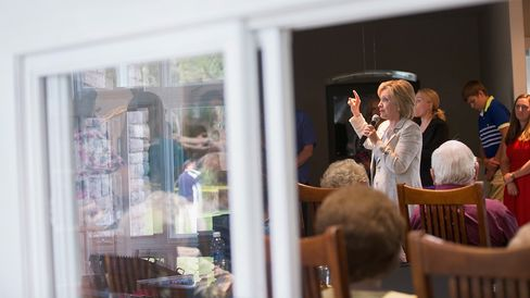 Former Secretary of State Hillary Clinton speaks to guests at a house party on July 26, 2015, in Carroll, Iowa.