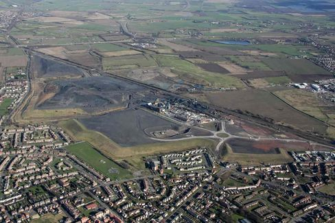 Dun-Colored Mine Tailings Loom Over the Village of Stainforth