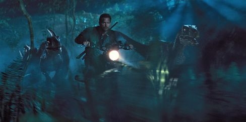 Chris Pratt is surrounded by raptors in Jurassic World.