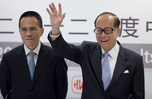 Li Ka-shing, right, and son Victor Li