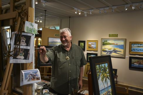 Local artist Mike Carroll working on a painting at his Mike Carroll Gallery in the heart of Lanai City.