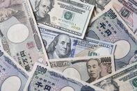 Japanese Yen and U.S. Dollar Banknotes Ahead of US-Japan Trade Talks