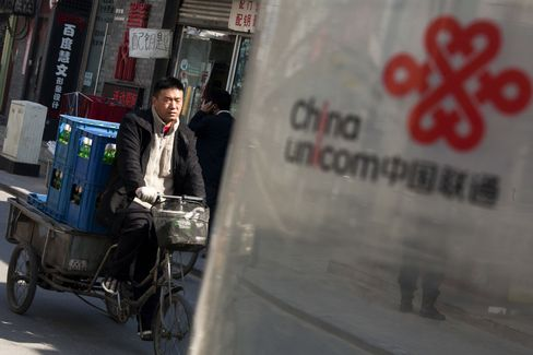 China Unicom Rises After Boost From Smartphones