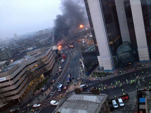Helicopter Crashes Near Thames in London, Fire Service Says