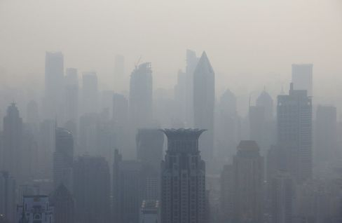 Commercial and residential buildings stand shrouded in haze in Shanghai, China.