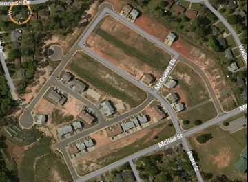 Satellite view of developed and undeveloped lots.