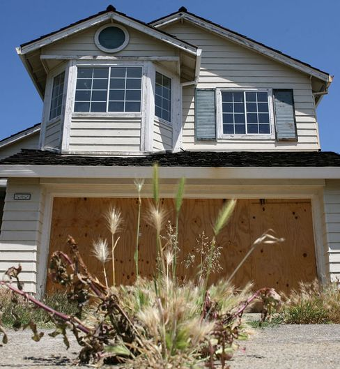 Foreclosures Prompt Cities to Sue Banks Over Mowing, Repairs