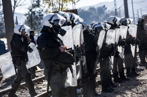 Greek police try to control the Greek-Macedonian border on Dec. 3