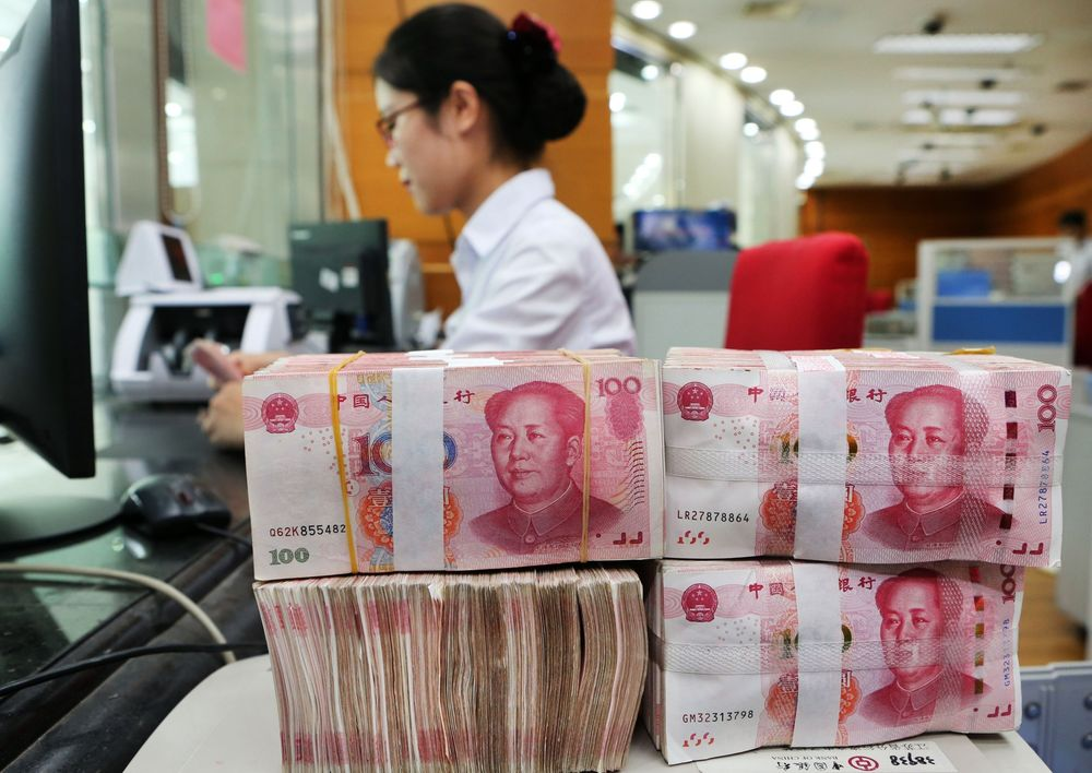 Why Is China's Currency Falling? - Bloomberg