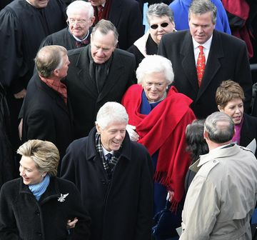 WASHINGTON, UNITED STATES:  Former US President George H.W. Bush(2nd-L) Greets his former Vice President Dan Quayle(L) as former First Lady Barbara Bush (C) stands by after inaugural ceremonies at the US Capitol in Washington, DC 20 January, 2005. Also pictured are Florida Governor Jeb Bush (2nd-R) his wife Columba(R) and former President Bill Clinton and his wife Sen. Hillary Clinton, D-NY (Bottom). AFP PHOTO/DON EMMERT  (Photo credit should read DON EMMERT/AFP/Getty Images)