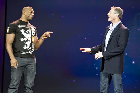 UFC fighter Alistair Overeem, left, and Paul Jacobs, Qualcomm's then CEO, speak at CES 2012.