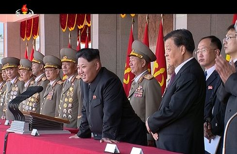 Kim Jong Un with China's Communist Party, Liu Yunshanm, watch the 70th anniversary parade in Pyongyang.