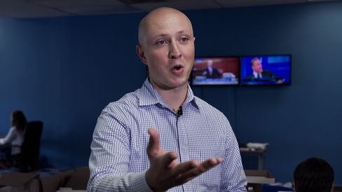 Adam J. Parkhomenko, Executive Director of the 'Ready For Hillary' Super PAC, working on behalf of undeclared US Presidential candidate and former US Secretary of State Hillary Clinton, is seen doing a TV interview July 11, 2013 at the PAC office in Alexandria, Virginia.