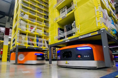 Kiva Systems LLC robots are used at the Amazon.com Inc. fulfillment center on Cyber Monday in Tracy, Calif.