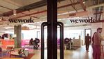 Signage is displayed on glass doors at the WeWork Cos. 32nd Milestone co-working space in Gurugram, India.