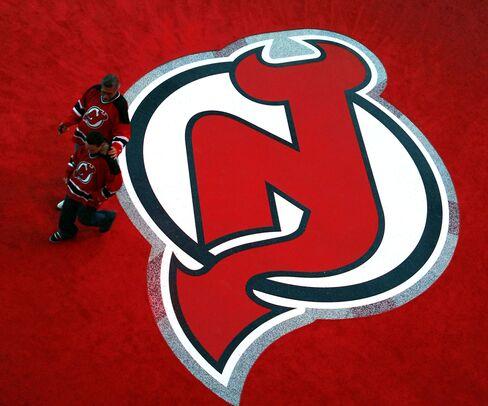 Apollo's Harris Buys NHL Devils, Adding to His Sports Portfolio