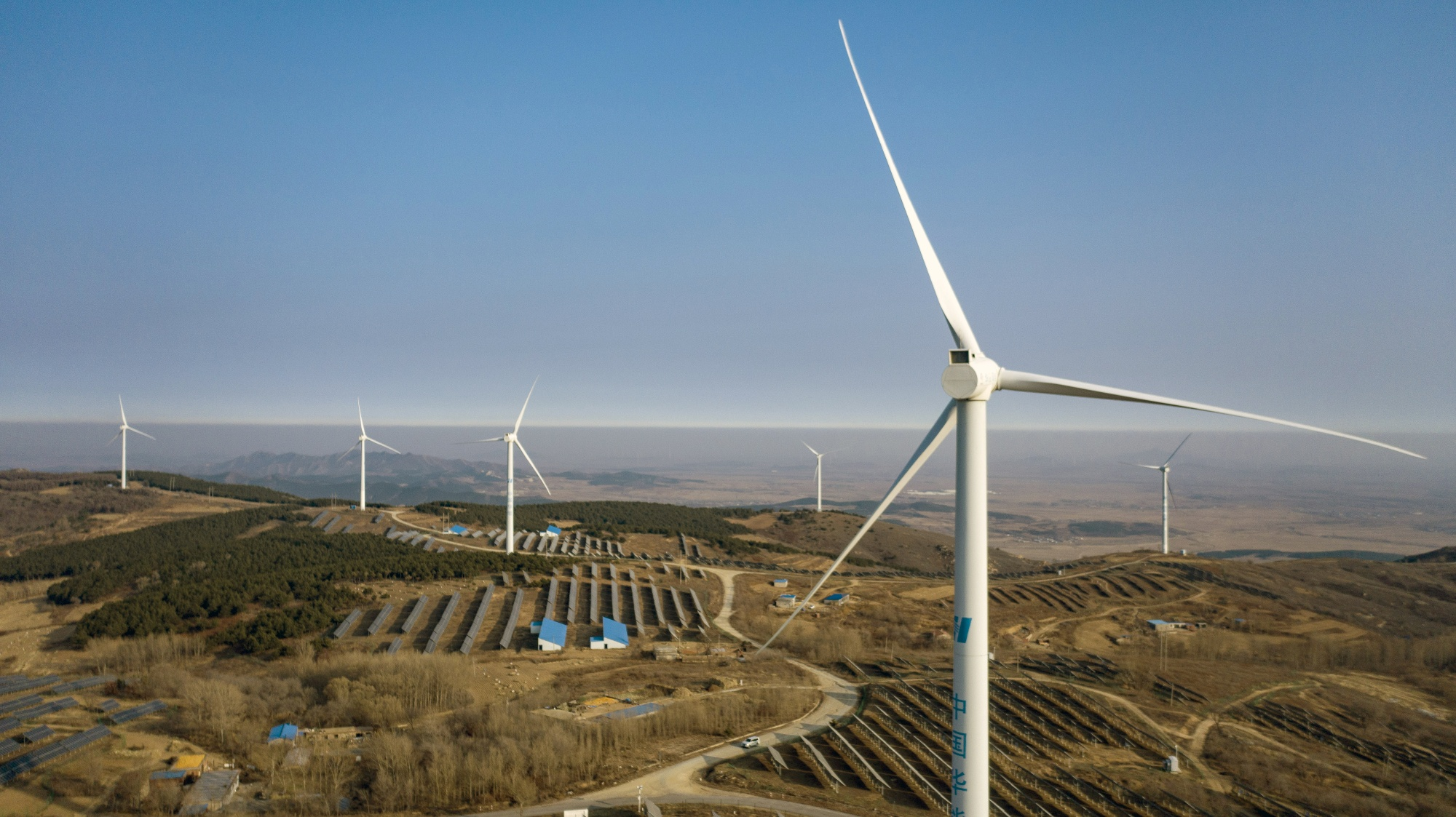 Wind turbines and solar panels in this aerial photograph taken near Fuxin, China, onNov. 16, 2020.