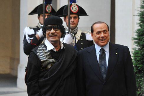 Berlusconi's 'Slavish' Courtship of Qaddafi Haunts Italy